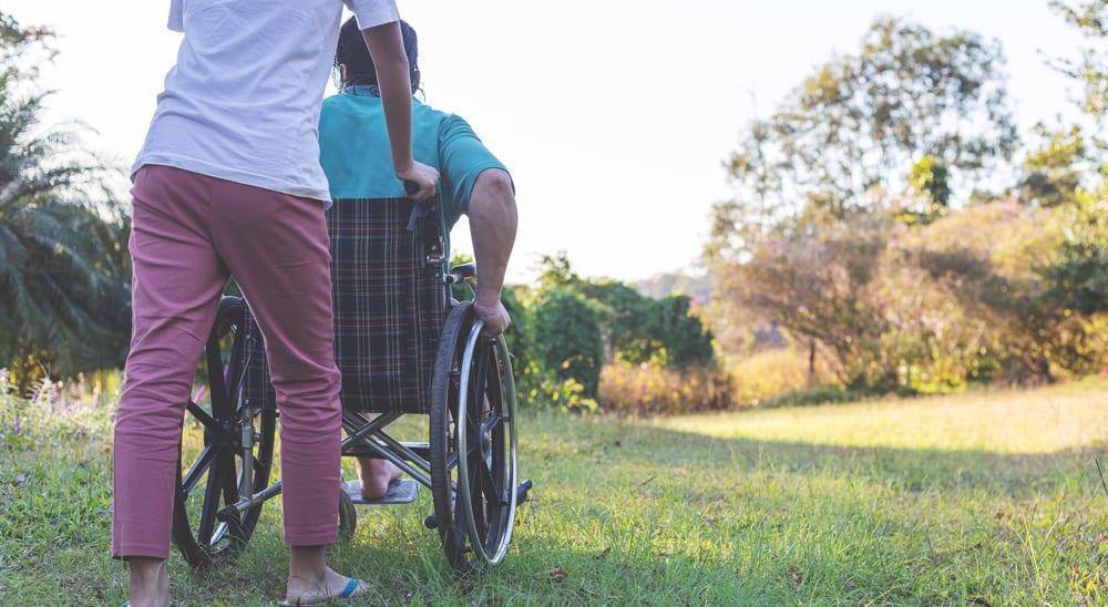 nurse and man on a wheel chair
